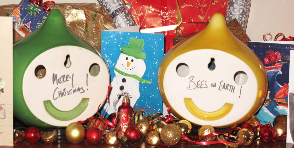 "two beepalaces viwed from behind with ""Meery Christmas"" and ""Bees on Earth"""